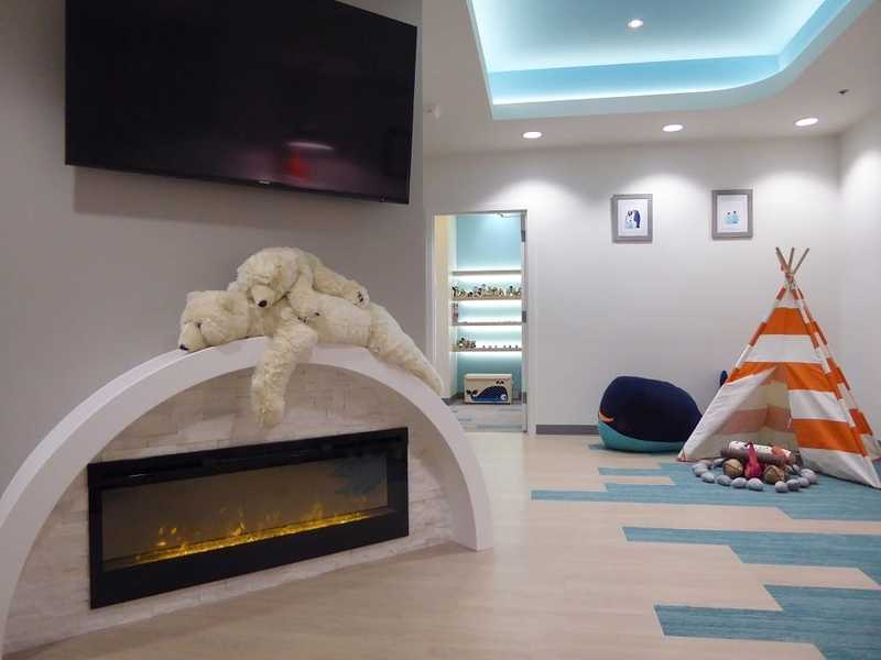 Redmond Ridge Pediatric Dentistry office with fake fireplace and polar bears, tepee and fire pit